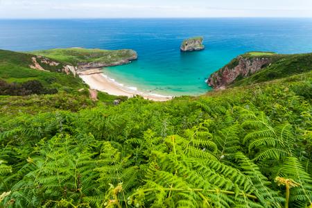 Ballota beach with the islet Castro, Llanes, Asturias , Spain
