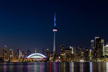 Night View of Downtown Toronto from Toronto Islands with the Lake Ontario, Canada.