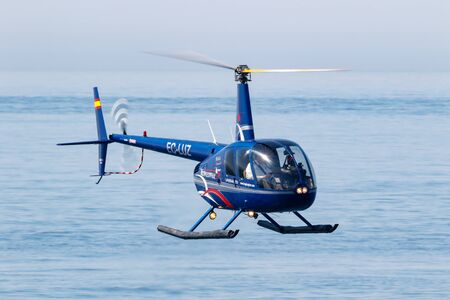 MOTRIL, GRANADA, SPAIN-JUN 17: Helicopter Robinson R44 taking part in an exhibition on the 13th international airshow of Motril on Jun 17, 2018, in Motril, Granada, Spain