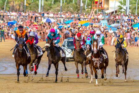 SANLUCAR DE BARRAMEDA, CADIZ, SPAIN - AUG 27: Unidentified riders race the second horses race called Fundacion Cajasol on August 27, 2016 in Sanlucar de Barrameda, Cadiz, Spain.