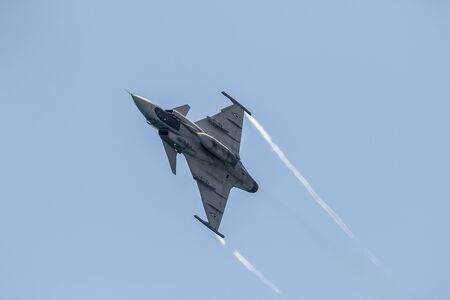 MOTRIL, GRANADA, SPAIN-JUN 11: Aircraft Saab Jas 39 Grippen taking part in a exhibition on the 12th international airshow of Motril on June 11, 2017, in Motril, Granada, Spain