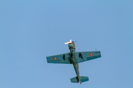 TORRE DEL MAR, MALAGA, SPAIN-JUL 30: Aircraft Yakolev Yak-52 of Salva Ballesta taking part in a exhibition on the 1st airshow of Torre del Mar on July 30, 2016, in Torre del Mar, Malaga, Spain Editorial