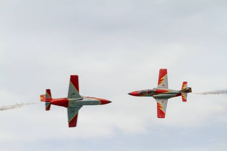 TORRE DEL MAR, MALAGA, SPAIN-JUL 31: Aircraft CASA C-101 of the Patrulla Aguila taking part in a exhibition on the 1st airshow of Torre del Mar on July 31, 2016, in Torre del Mar, Malaga, Spain Editorial