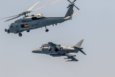 MOTRIL, GRANADA, SPAIN-JUN 11: Aircraft AV-8B Harrier Plus and  helicopter SH-60 Seahawk taking part in an exhibition on the 12th international airshow of Motril on Jun 11, 2017, in Motril, Granada, Spain
