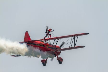 TORRE DEL MAR, MALAGA, SPAIN-JUL 30: Wingwalker Danielle on the Aircraft Boeing Stearman taking part in a exhibition on the 1st airshow of Torre del Mar on July 30, 2016, in Torre del Mar, Malaga, Spain Editorial