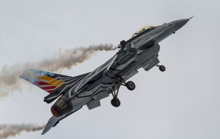 TORRE DEL MAR, MALAGA, SPAIN-JUL 31: Aircraft F-16 Belgian solo display taking part in a exhibition on the 1st airshow of Torre del Mar on July 31, 2016, in Torre del Mar, Malaga, Spain