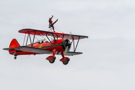 TORRE DEL MAR, MALAGA, SPAIN-JUL 31: Wingwalker Danielle on the Aircraft Boeing Stearman taking part in a exhibition on the 1st airshow of Torre del Mar on July 31, 2016, in Torre del Mar, Malaga, Spain Editorial