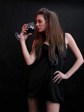 beautiful young woman with a glass of red wine. Stock Photo