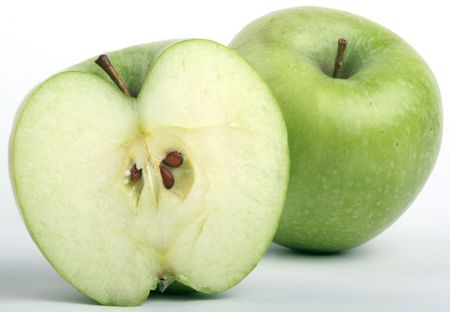 Half of a green apple and a whole behind