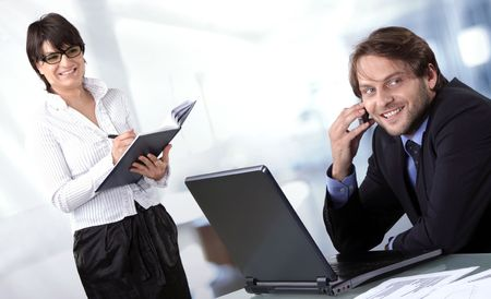 Two business people smiling Stock Photo - 5113070
