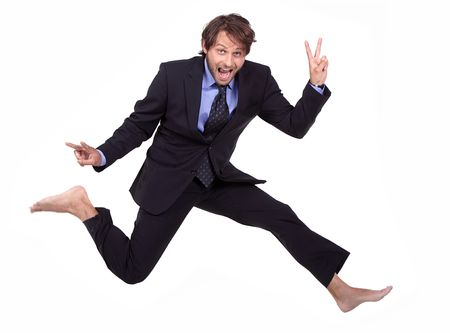 crazy dude in a suit, is jumping barefoot and making v-sign