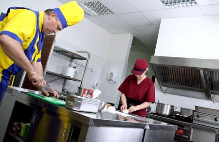 couple of cooks in a restaurant kitchen