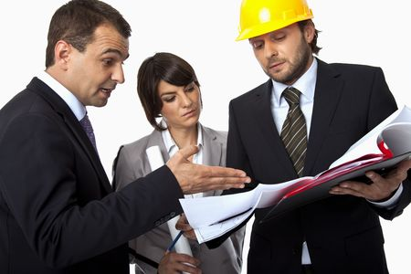 three people are arguing over a plan, one with a helmet