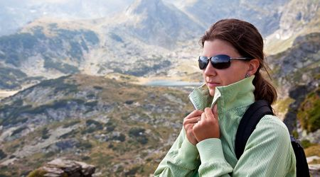 young female with sun glasses high in the mountains