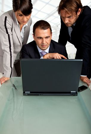team of three business people , looking at the monitor of a laptop Stock Photo - 5490006