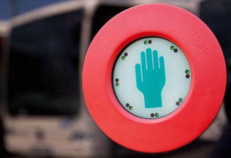 close-up of a touch-button of a bus door Stock Photo
