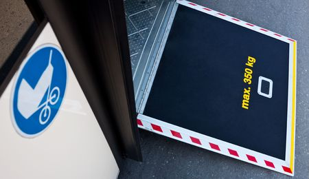 a platform on a bus door with a stroller icon
