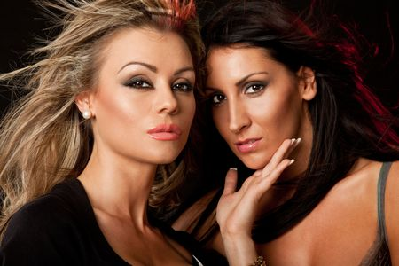 portrait of two beautiful woman, blond and brunette