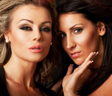 close-up of two beautiful woman, blond and brunette