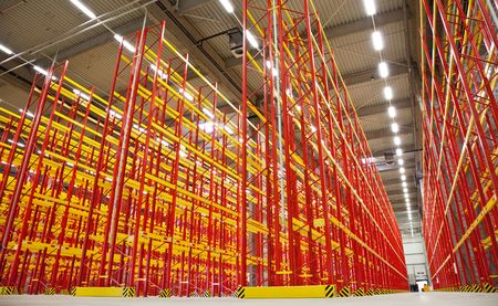huge warehouse inside with empty racks in red Stock Photo