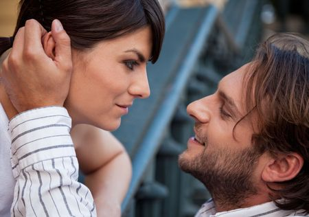 warm communication of a young heterosexual couple outdoors Stock Photo