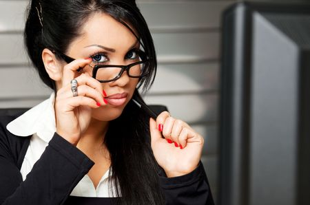 beautiful young female with glasses in the office Stock Photo