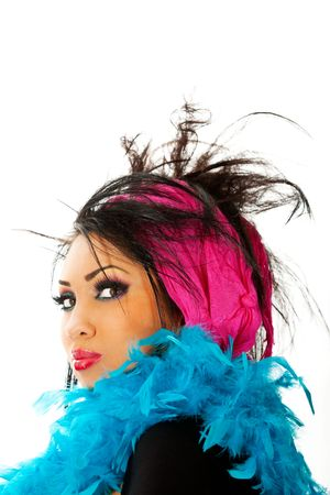 portrait of a young hispanic female with feathers and hairstyle Stock Photo