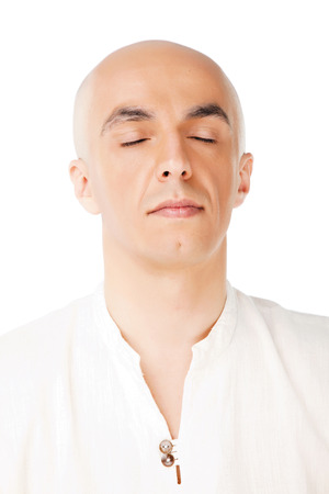 eye's closed: Portait of a bald male meditating isolated, eyes closed Stock Photo
