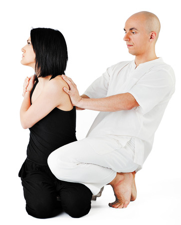 recovery position: Therapist giving traditional thai massage on woman