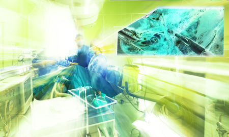 Abstract blurred image of hospital surgery room with team of doctors operating.