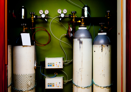 Bottles and controls of a high pressure gas station for medical gases.