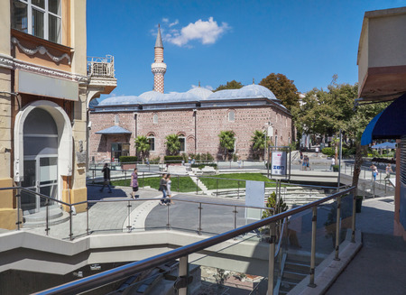 "str: Dzhumaya, Djumaya Mosque or Cuma Camii in turkish, downtown Plovdiv view throght ""Knyaz Alexander I"" str. and the Roman Stadium on a sunny summer day."