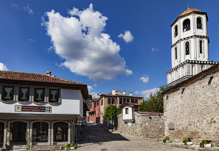 A view of one of the main streets in old town of Plovdiv, Bulgaria with the dome of St. St. Constantine and Helena church Stock Photo