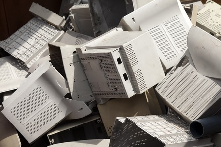A pile of old broken monitor plastic shells ready for recycling. Stock Photo