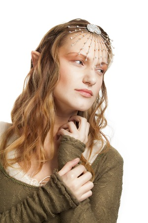 A portrait of a beautiful woman with tiara and elfs ears. Stock Photo