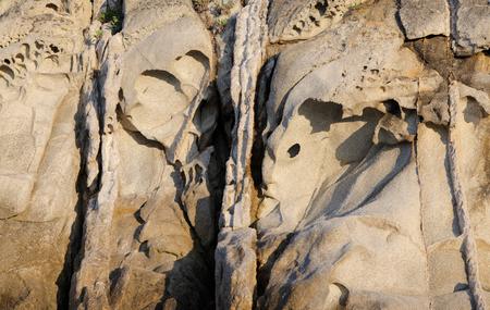 An interesting rock face-like formation background. Banco de Imagens