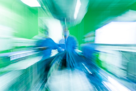 An abstract image of modern hospital surgery in green and blue with copy space.