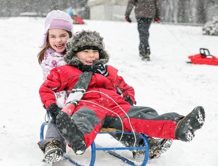 Kids Sledding Fun Snow Banco de Imagens