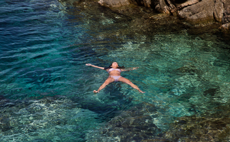 Female swimming in Clear Water sea