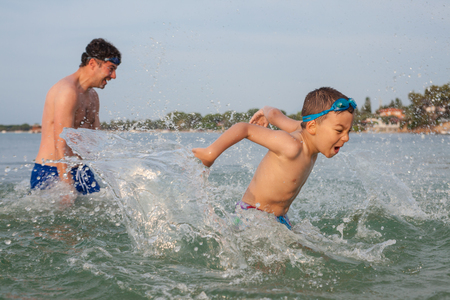 Boy Son Father Play Sea Splashing Stock Photo