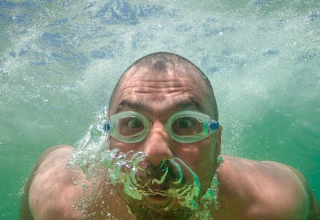 Funny Male Face Underwater Goggles Stock Photo