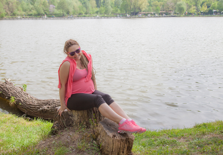 Pregnant Woman Outdoors Smiling Dam