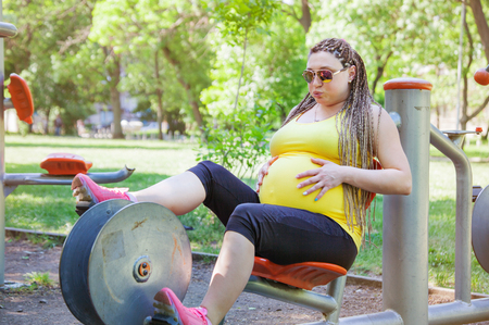 Pregnant Woman Cycling Fitness Stock Photo