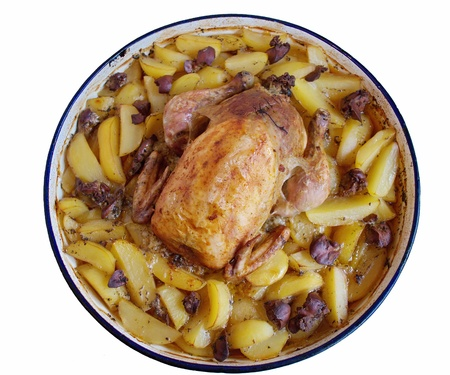 Closeup of roast chicken full of  rice liver and oven potatoes photo