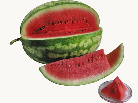 Ripe watermelon fruit and slice isolated on white background