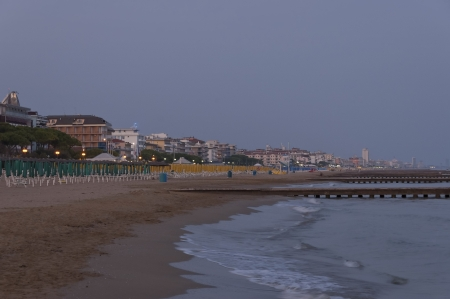 The beach in Lido di jesolo at dusk after sunset, Adriatic sea, Italy, venetian Riviera photo