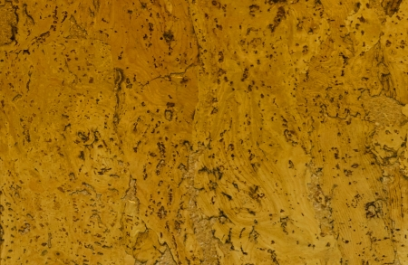 flooring cork: Background of rich cork patterned texture in color gold.  Stock Photo