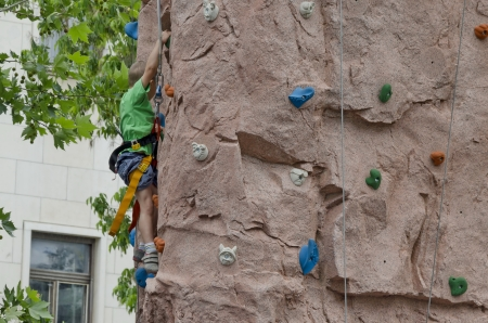 Artificial climbing wall for practical training in children day    photo