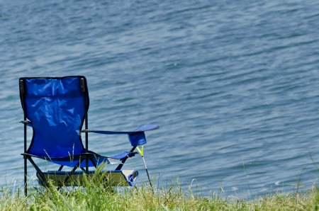 1040; folding fishing chair at shore of Iskar dam  Stock Photo