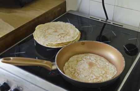 Frying pan on stove with fresh roast pancake  Stock Photo